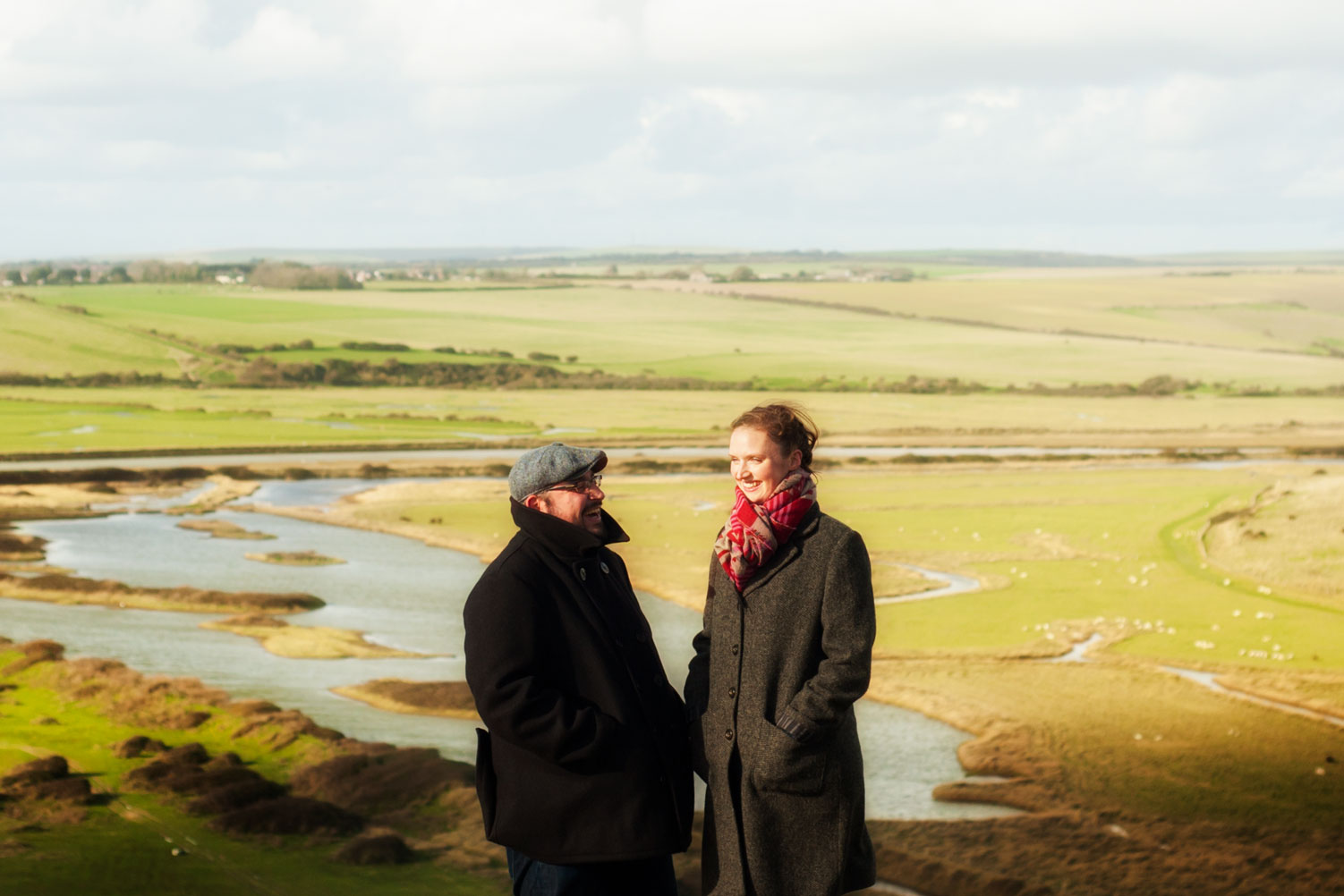 Couple walking in Seven Sisters country park