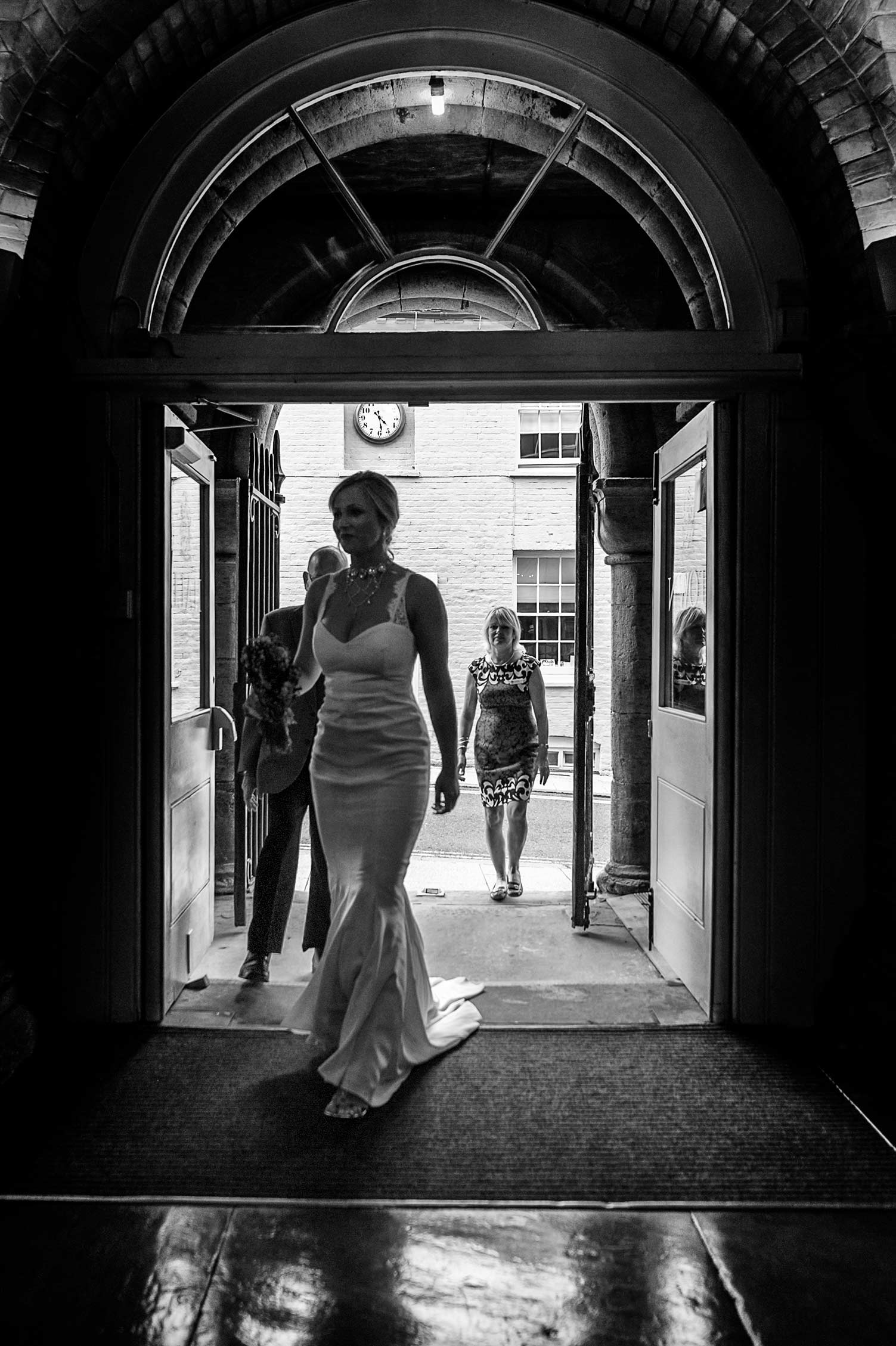 Bride arriving at Arundel Town Hall by Sussex documentary wedding photographer James Robertshaw