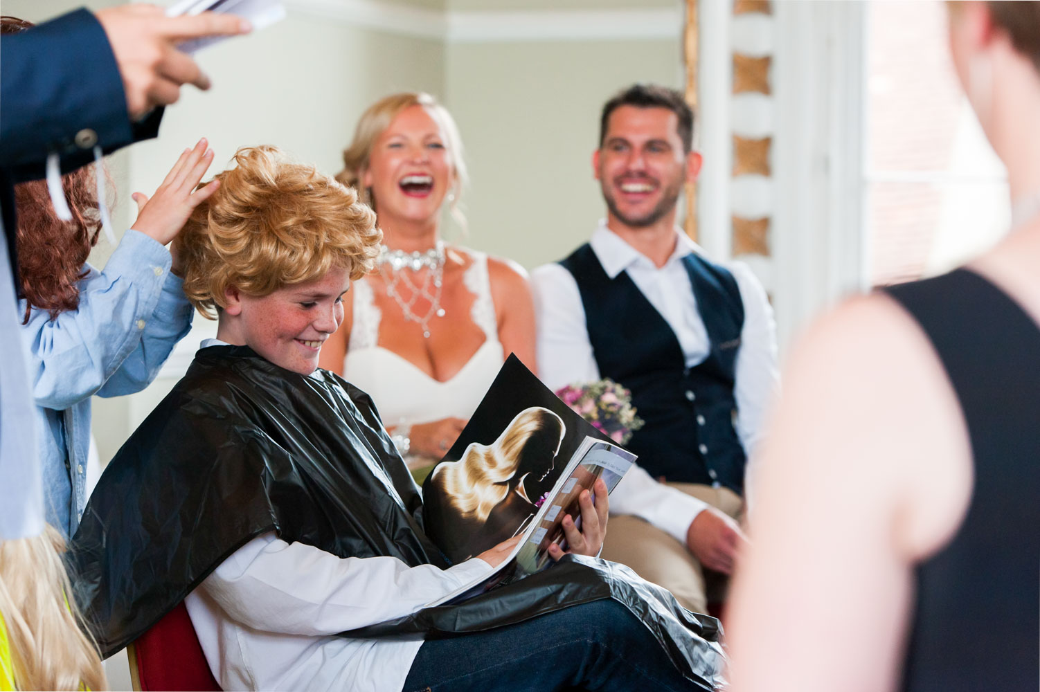 Bride and groom enjoying kids comedy performance during wedding ceremony