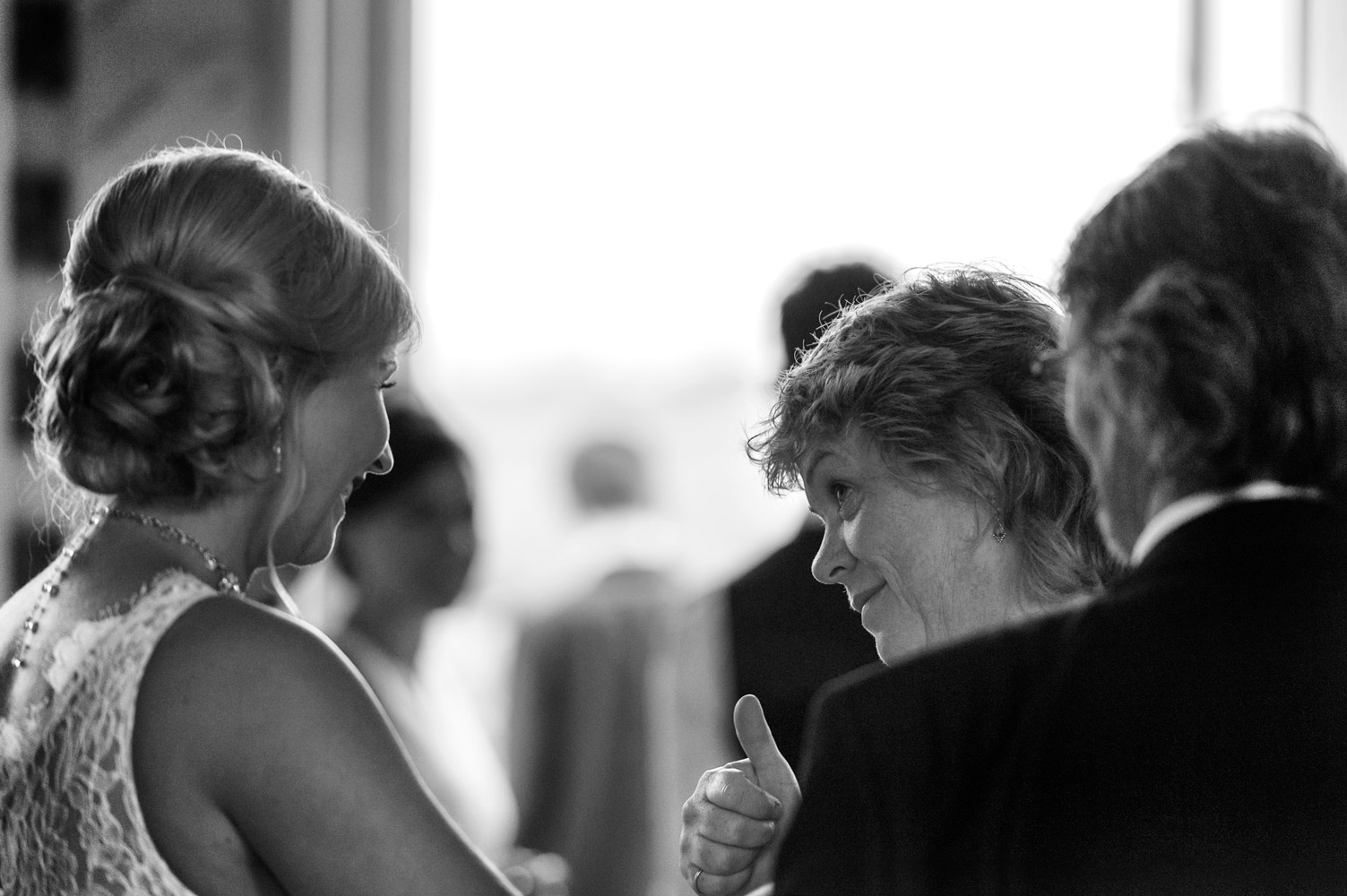 Guest giving bride thumbs up