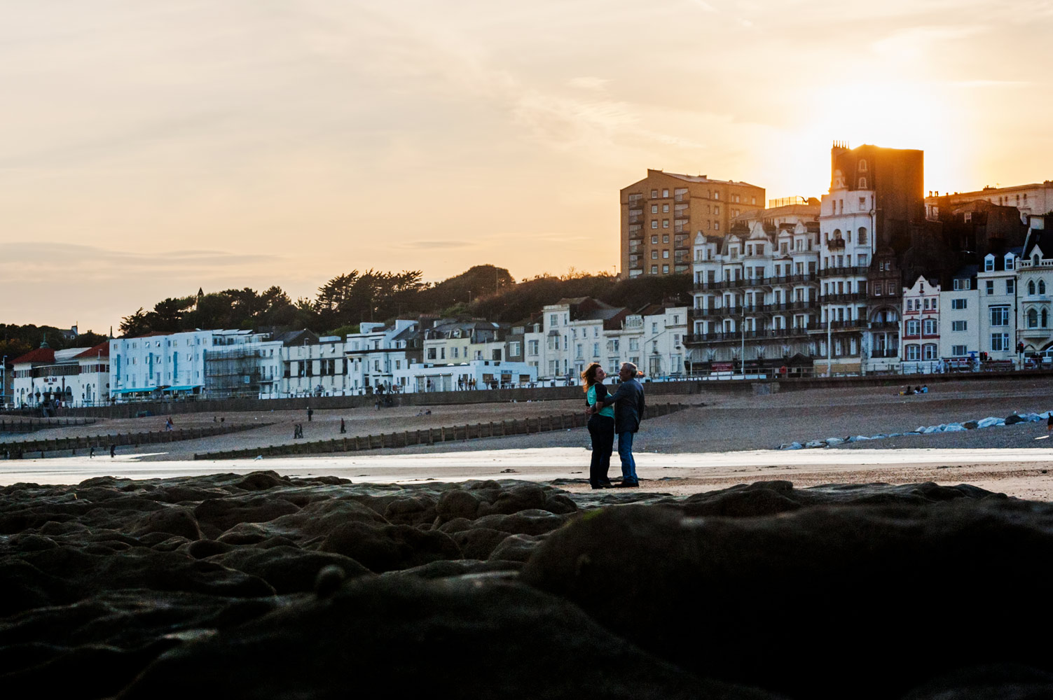 Couple embracing on Hastings beach