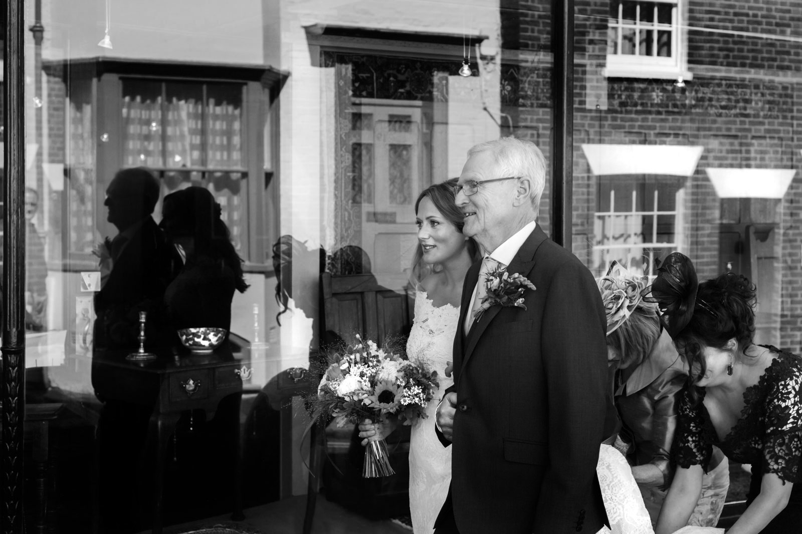 Bride walking with father to Rye Town Hall wedding
