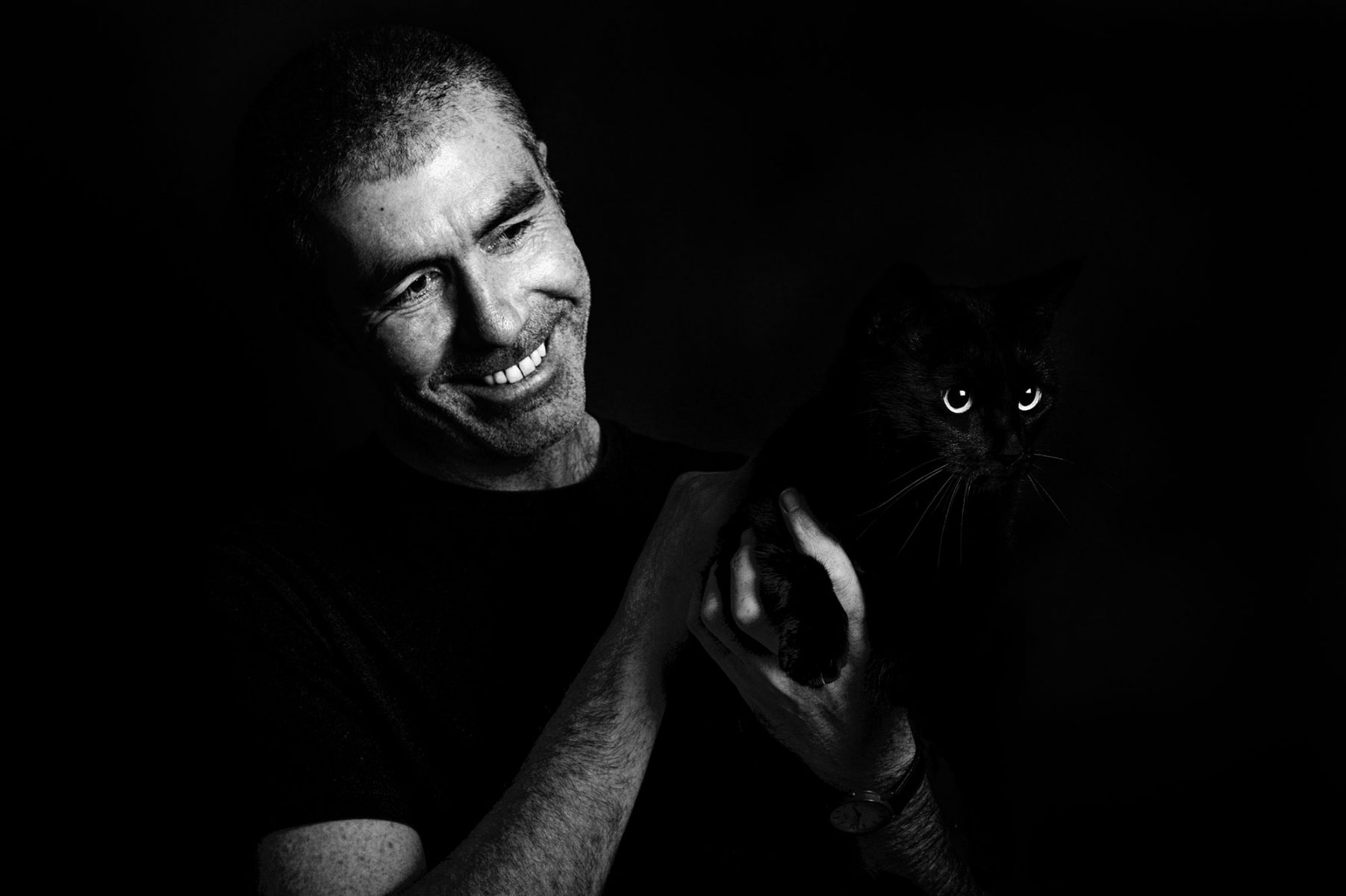 Self portrait of James Robertshaw holding his cat