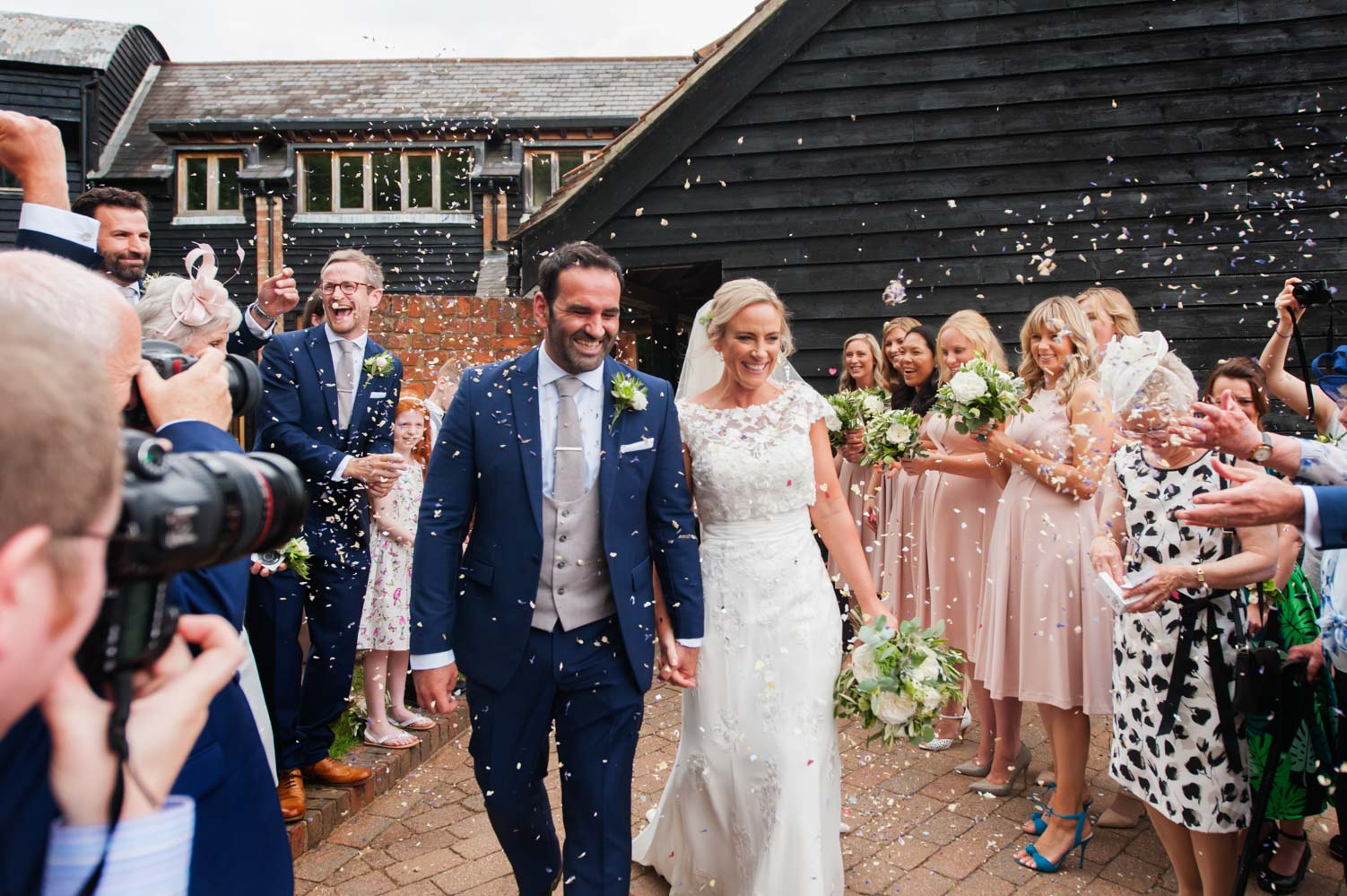 Confetti at Tewin Bury Farm wedding by Sussex wedding photographer James Robertshaw.