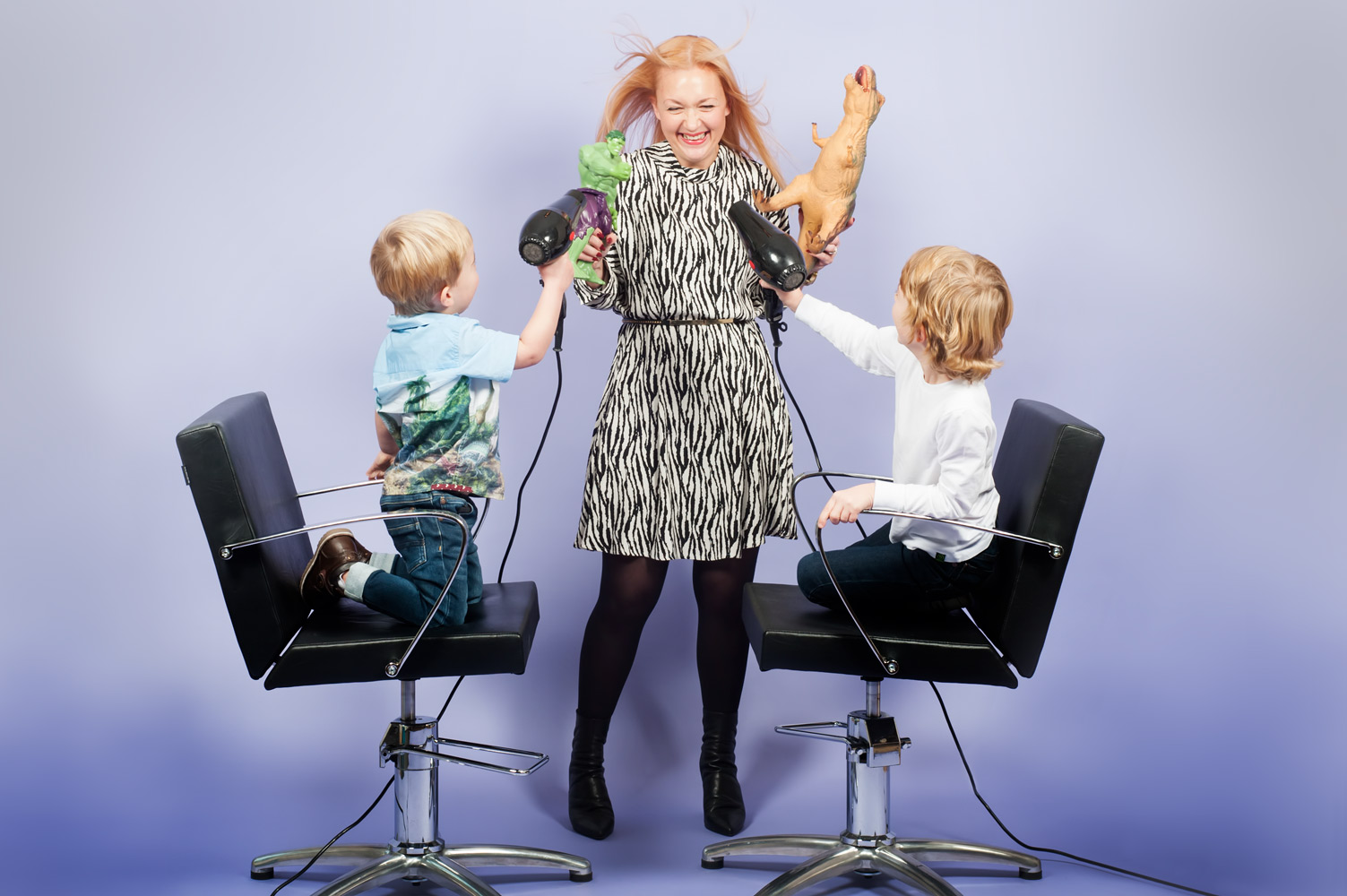 Portrait of hair stylist with her two children