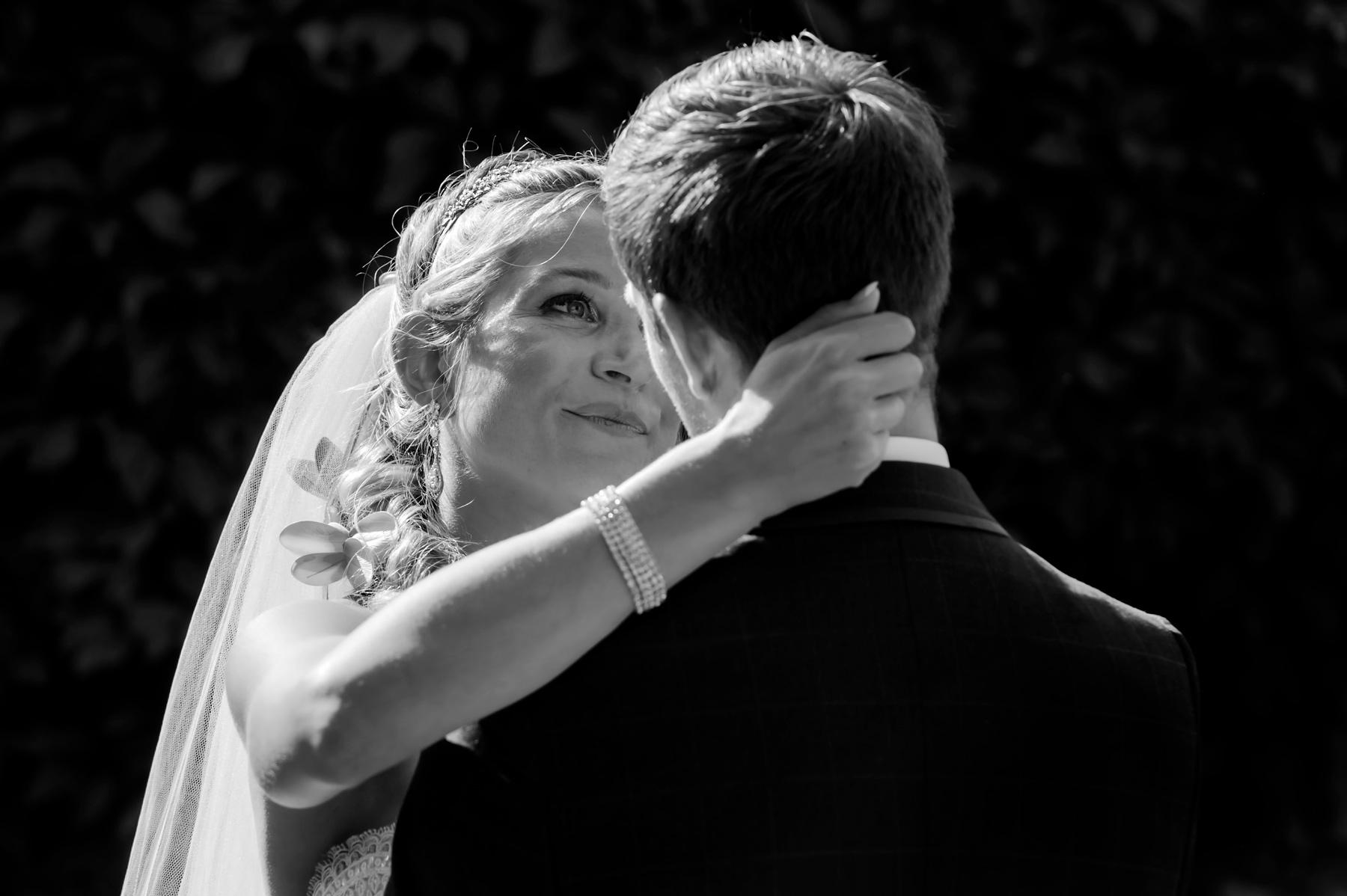 Bride looking lovingly at new husband