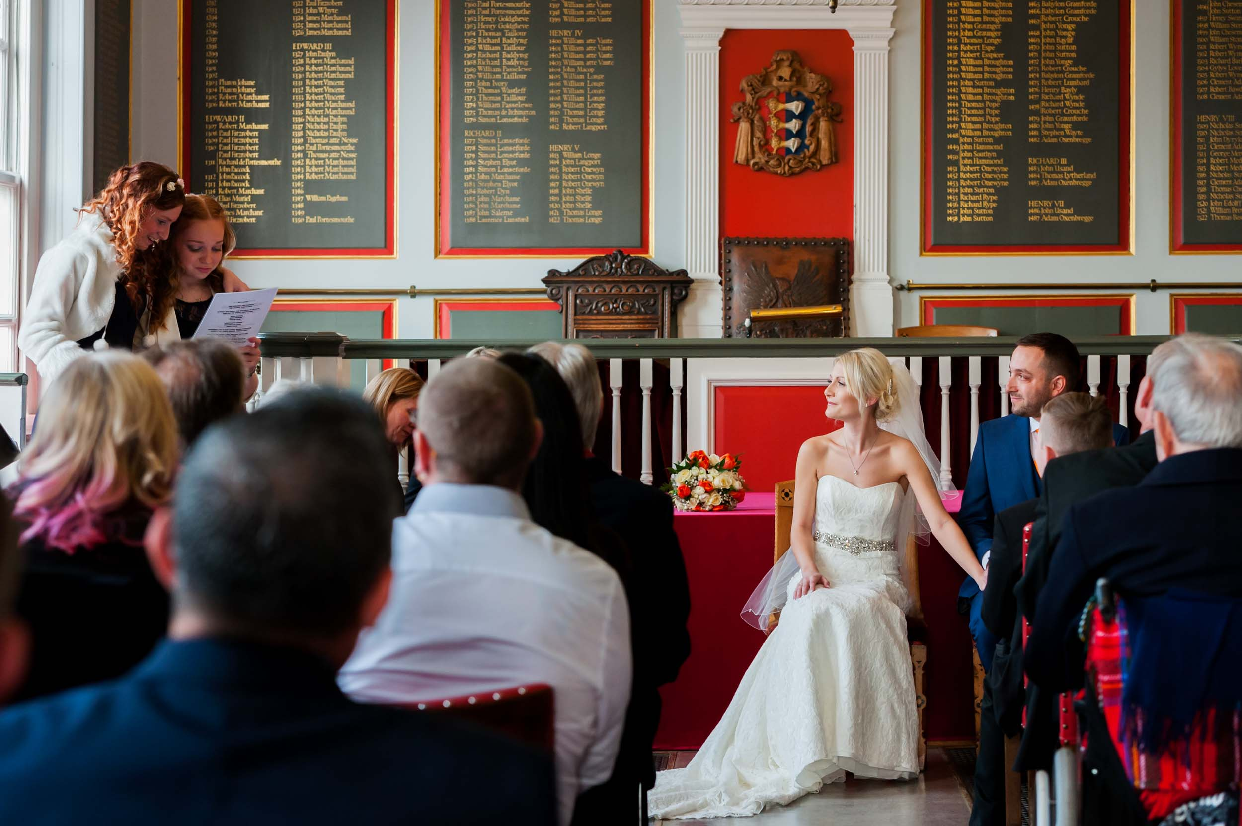 Emotional reading during ceremony by sussex wedding photographer James Robertshaw.